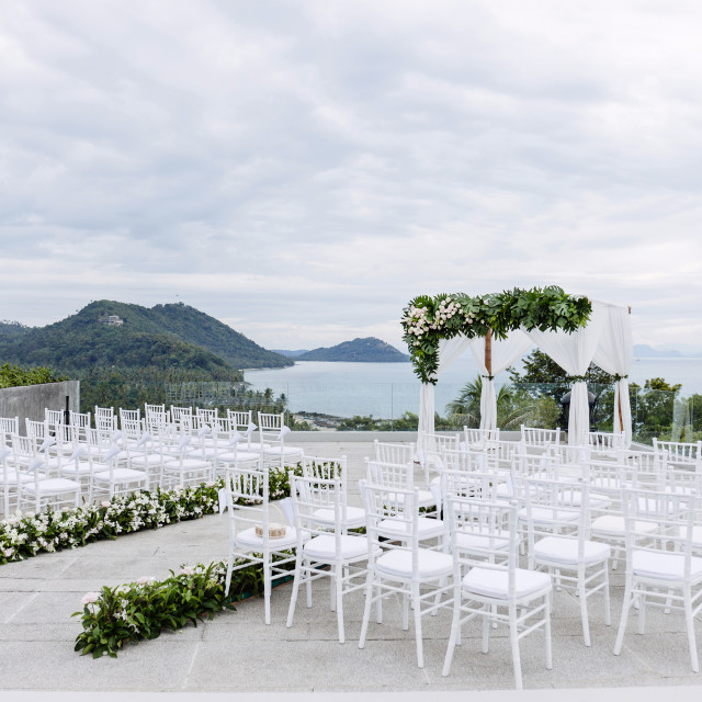 """Wedding venue setup on the hill, Roses, flowers, floral decoration with panoramic ocean view"" stock image"