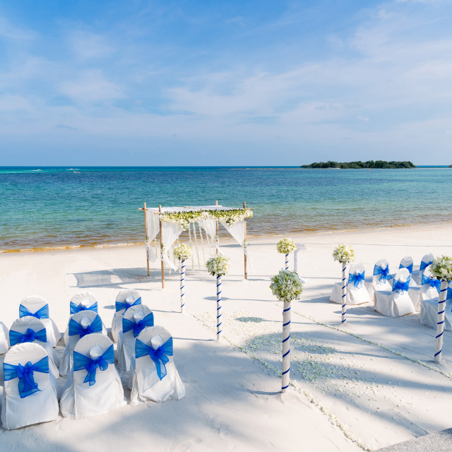 """Wedding venue setup on the beach with panoramic ocean view"" stock image"