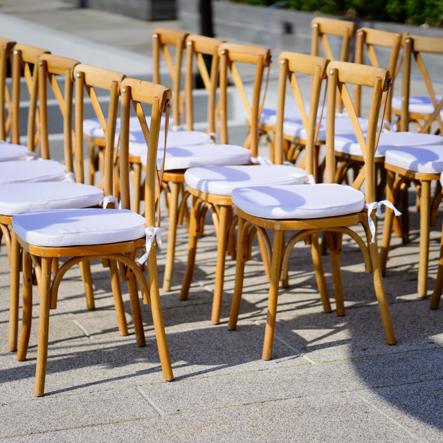 """Folding lawn chairs setup for beach wedding - Front, Side view with deph"" stock image"