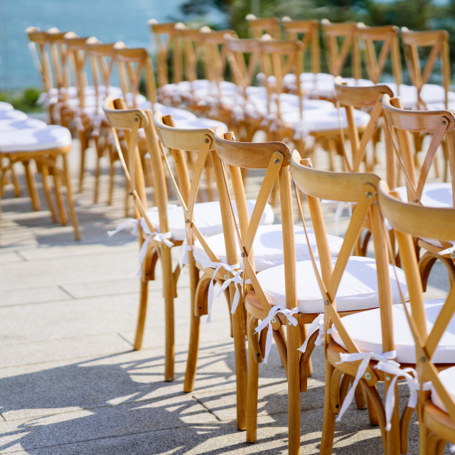 """Folding lawn chairs setup for beach wedding - Back, Side view with deph"" stock image"