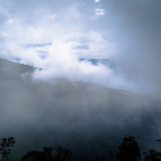 """Baños - August 19, 2018: Natural misty landscape of the region of Baños, Ecuador"" stock image"