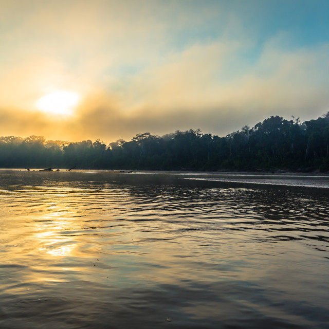 """""""Manu National Park, Peru - August 07, 2017: Sunrise by the shores of the..."""" stock image"""