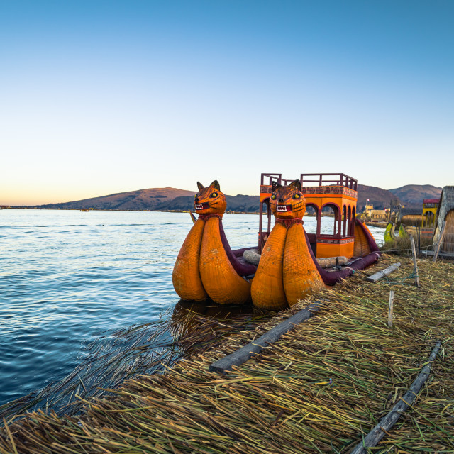 """Puno, Peru - July 30, 2017: Boats of the traditional Uros village in Puno, Peru"" stock image"
