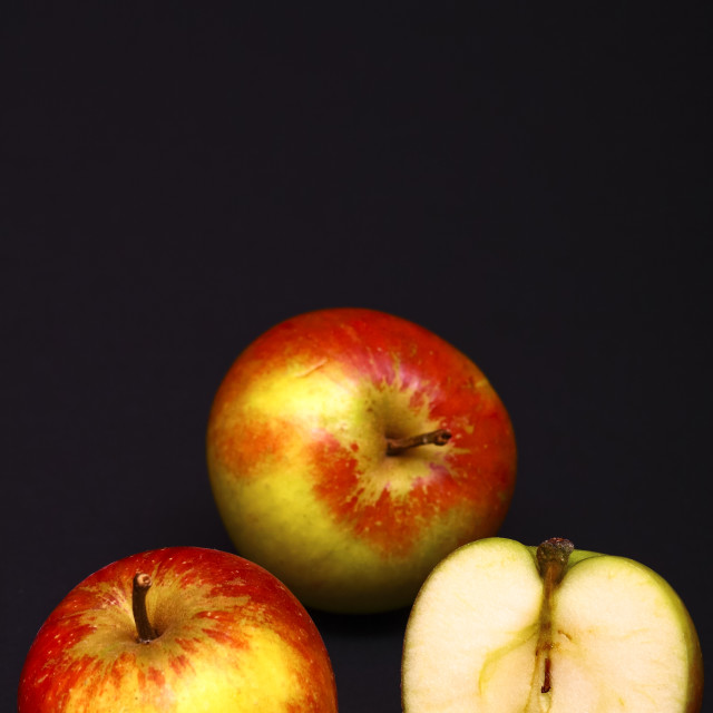 """""""Two whole red apples and one sliced in half"""" stock image"""