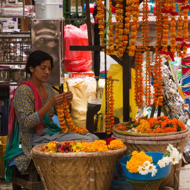 """Flower garland seller on the streets of Kathmandu, Nepal"" stock image"