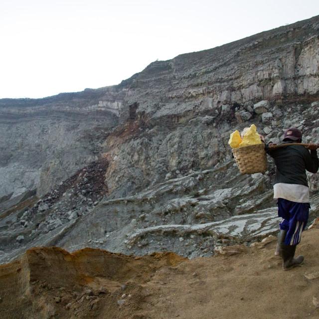 """Sulphur miner of Ijen volcano, Eastern Java, Indonesia"" stock image"