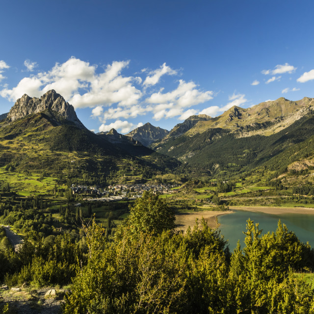 """Pena Foratata peak, Lanuza lake and this scenic Tena Valley mountain town...."" stock image"