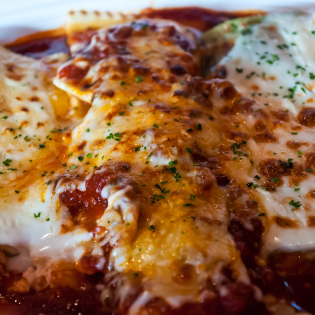 """Closeup of Cheese Enchiladas"" stock image"