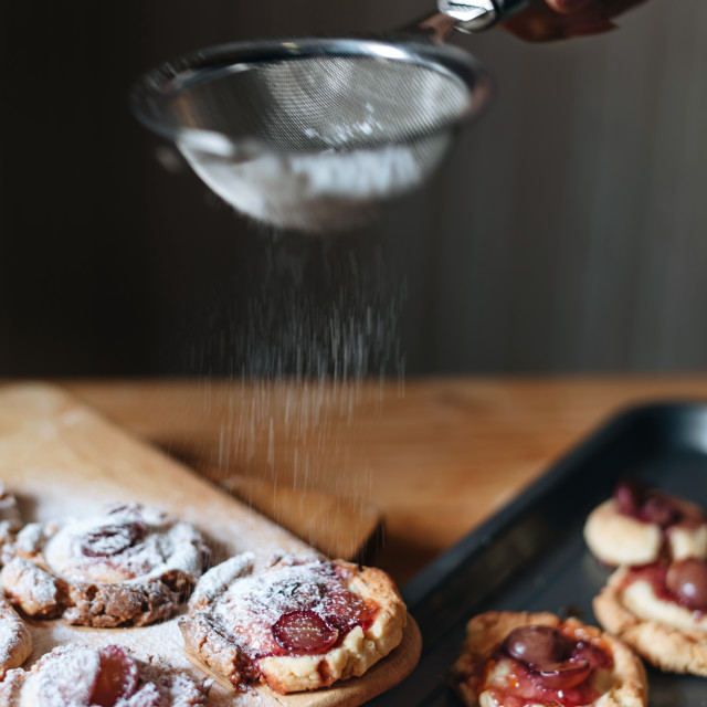 """Sprinkle the powdered sugar on cookies"" stock image"