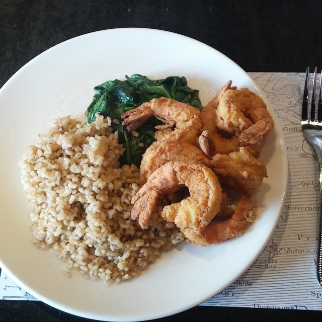 """Plate of brown rice, fried shrimp and spinach"" stock image"