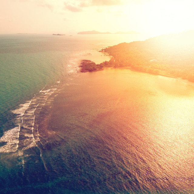 """""""Aerial view of sunset over emerald tropical sea"""" stock image"""