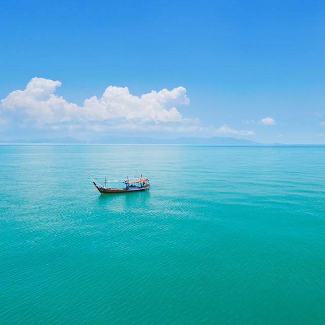 """""""Aerial panoramic view of fishing boat on emerald sea"""" stock image"""
