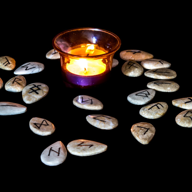 """Runes Around A Candle"" stock image"