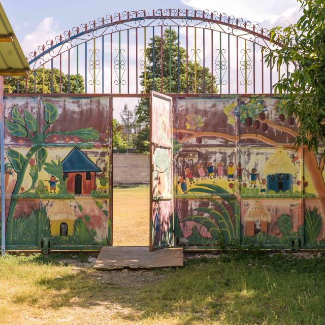 """Large painted metal gate in Haiti"" stock image"