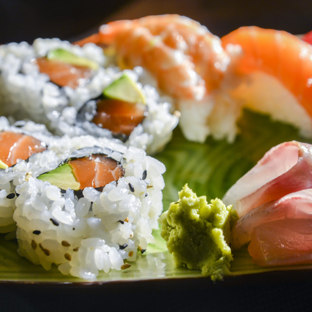 """Sushi and sashimi set with wasabi and ginger on a plate"" stock image"