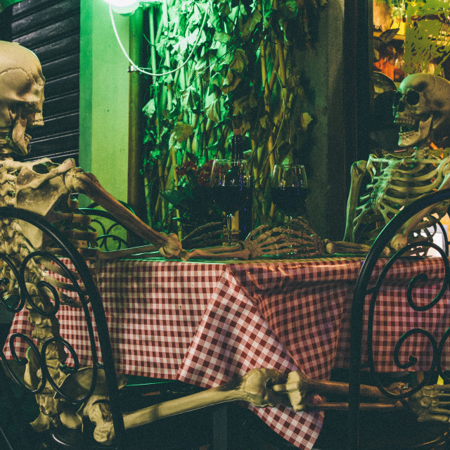"""Skeletons on a date"" stock image"