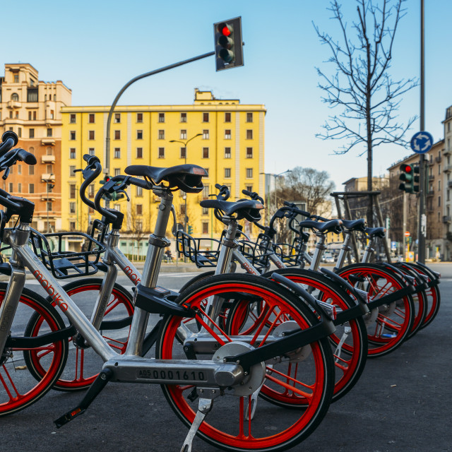 """""""'Free floating' Chinese Mobike sharing bike-scheme in Milan, Italy. Locals..."""" stock image"""