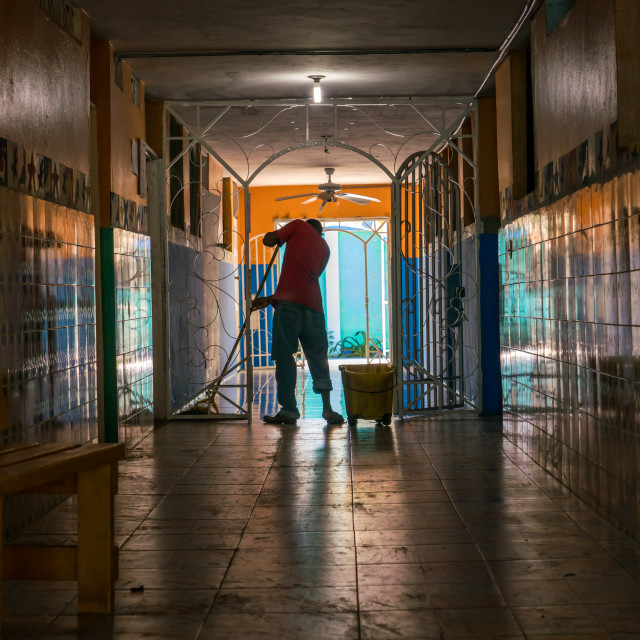 """""""Mopping floors in Haitian orphanage"""" stock image"""