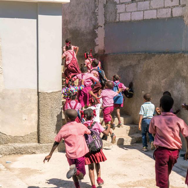 """""""Haitian school children run up stairs."""" stock image"""