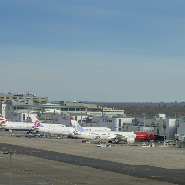 """""""Airplanes of different airliners on tarmac awaiting passengers at London..."""" stock image"""