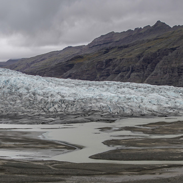 """Glacier with stormy sky"" stock image"
