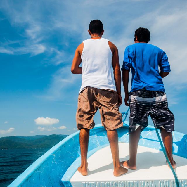 """Men Guiding Water Taxi"" stock image"
