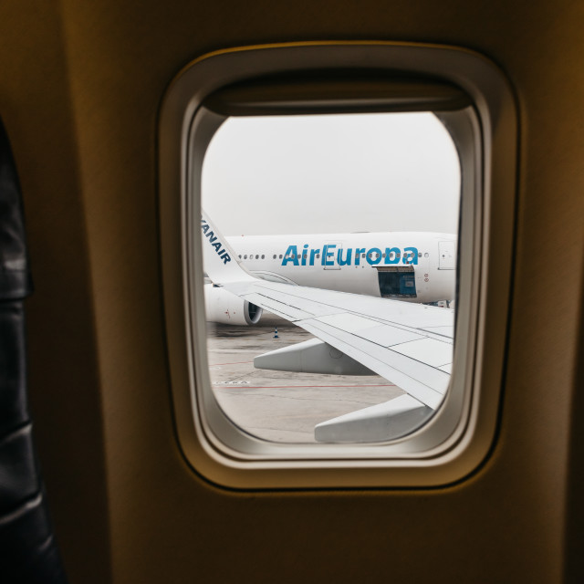 """View through window of airplane"" stock image"