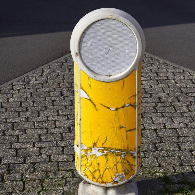 """Weather worn and cracked traffic bollard"" stock image"