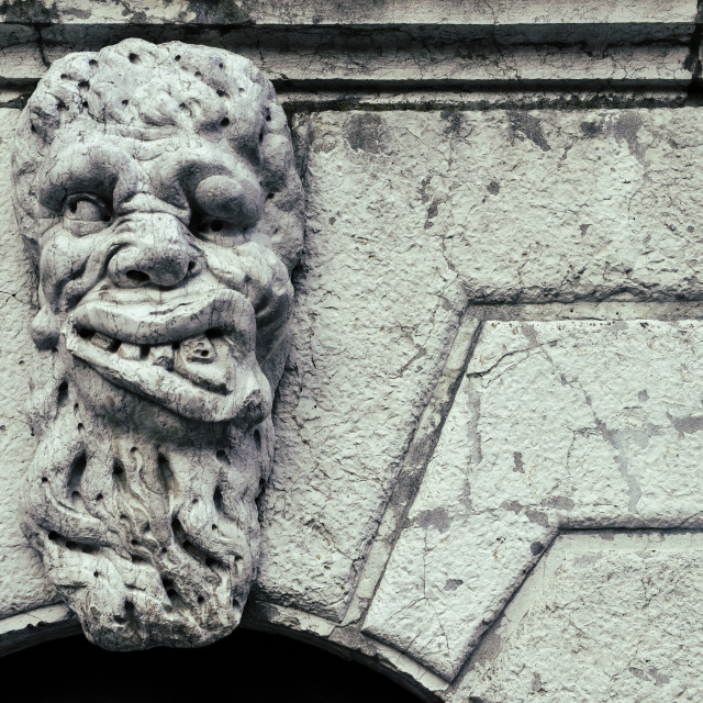 """Grotesque Face of a monster sculpture on a Church in Venice"" stock image"