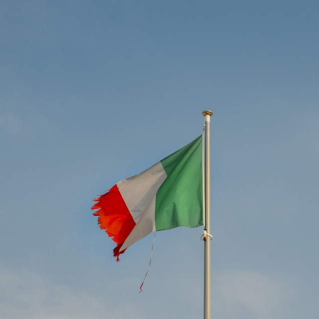 """Italian flag on the mast blowing in the wind with ripped corners, perhaps a..."" stock image"