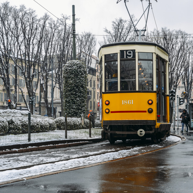 """Old Style 1920s tram under the snow in the city of Milan, Italy"" stock image"