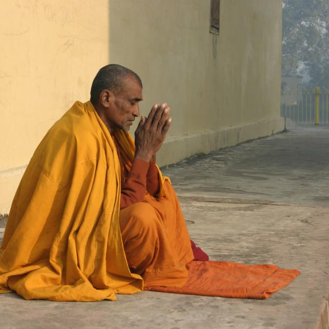 """Monk praying at Mahaparinirvana Temple"" stock image"