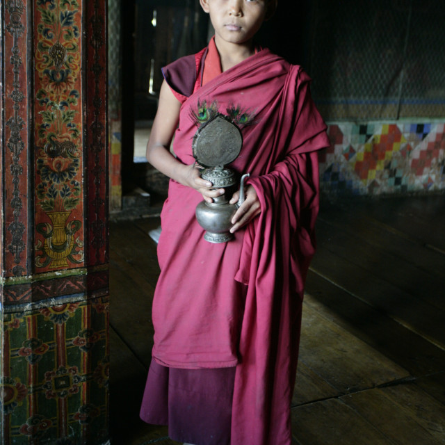 """""""Young monk with ritual objects, Bhutan"""" stock image"""