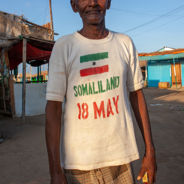 """Old somali man wearing a shirt for the national day, Awdal region, Zeila,..."" stock image"