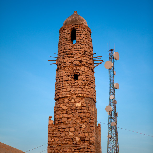 """Old mosque and telecom antennas, Awdal region, Zeila, Somaliland"" stock image"