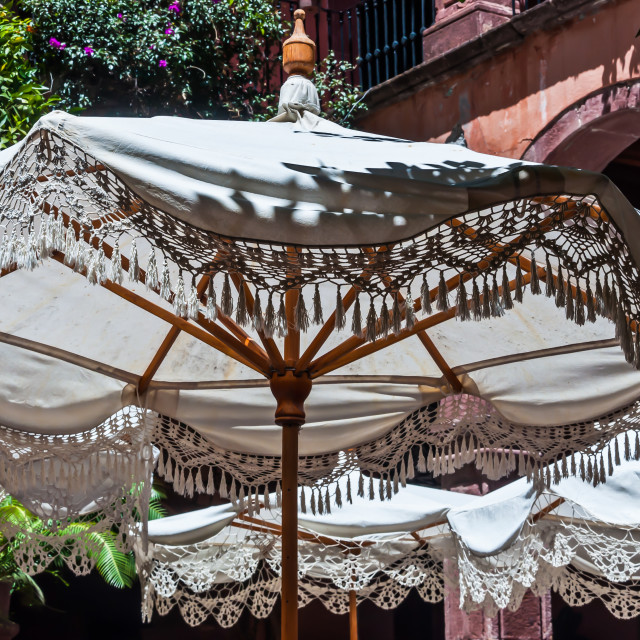 """Closeup of White Patio Table Umbrella"" stock image"