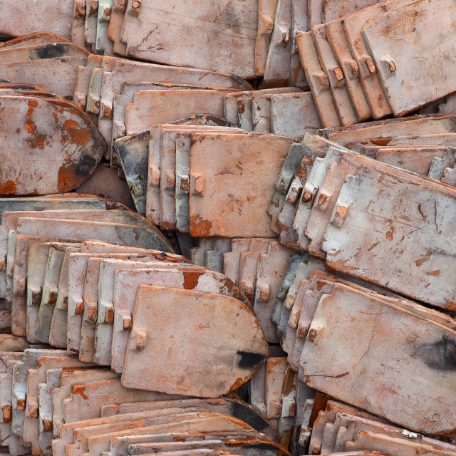 """Close up of piles of old roof tiles"" stock image"