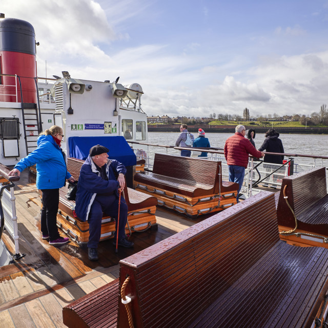 """""""Passengers on the outside deck of Mersey Ferry"""" stock image"""