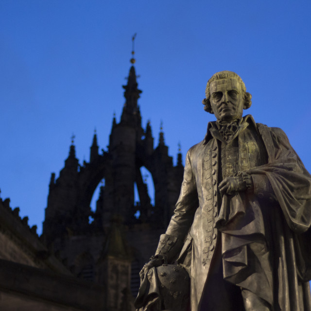 """""""Adam Smith statue, The Royal Mile. St. Giles Cathedral silhouette. Edinburgh."""" stock image"""