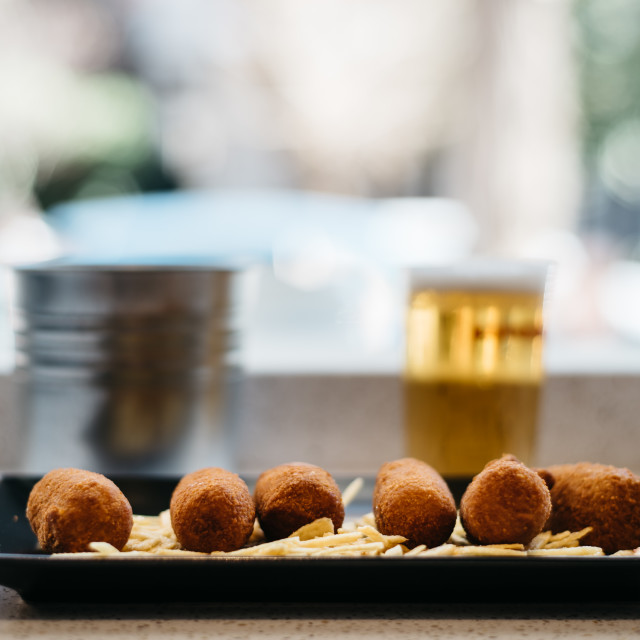 """Close up of croquettes with potatoes with beer on background"" stock image"