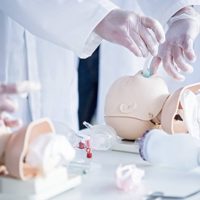 """Doctors practising infant intubation"" stock image"