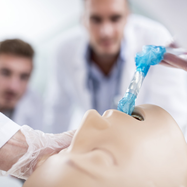 """Doctor practising intubation on a dummy"" stock image"