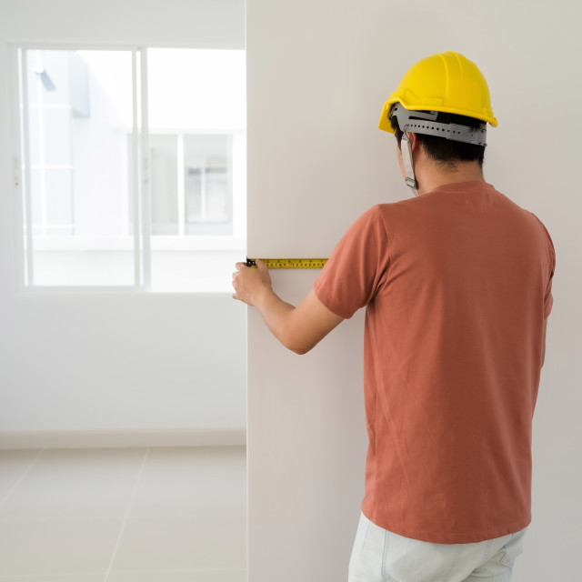 """Interior engineer measure new house wall"" stock image"