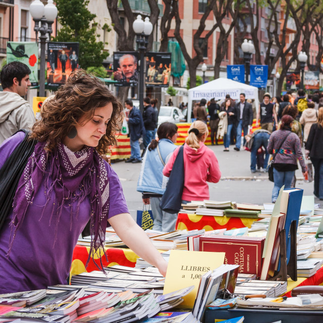 """Woman browsing at street bookstall on La Rambla Nova in Tarragon"" stock image"