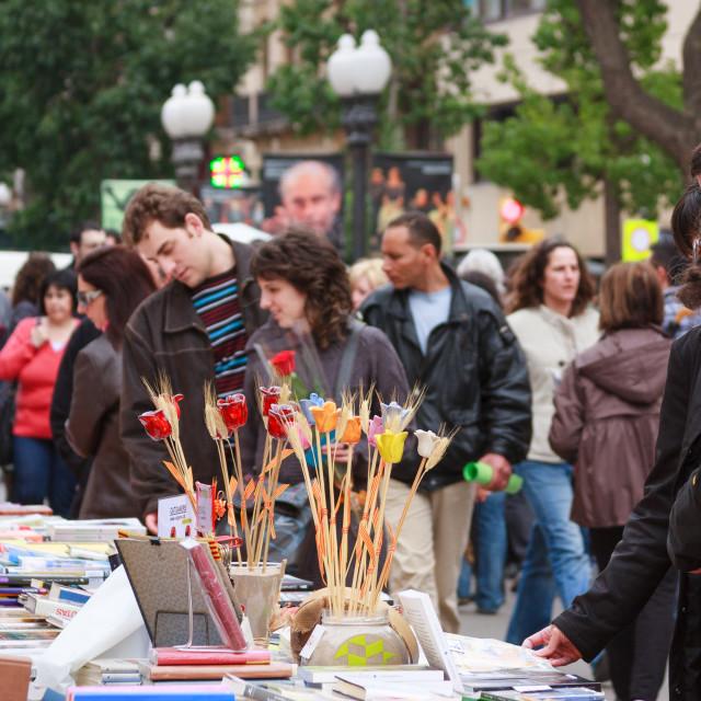 """People browsing books at a stall on the Rambla Nova, Tarragona,"" stock image"