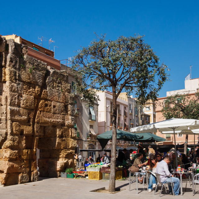 """Outdoor market and cafe by roman ruins in la plaza del forum, Ta"" stock image"
