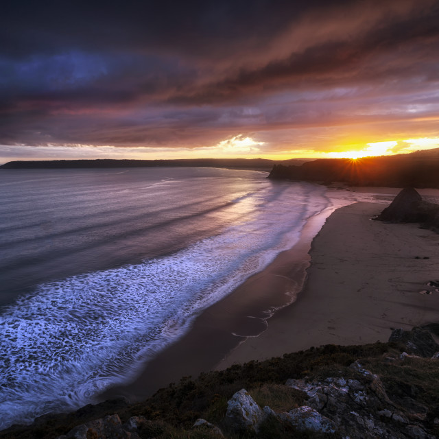 """Gower sunset at Three Cliffs Bay"" stock image"