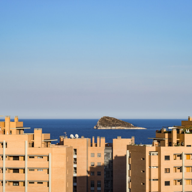 """Benidorm Island framed by apartment blocks."" stock image"