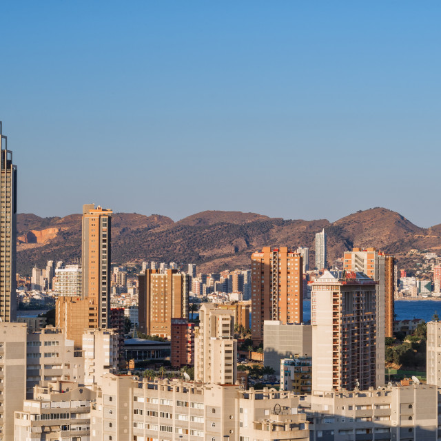 """The famous Benidorm skyline with mountains on the horizon."" stock image"
