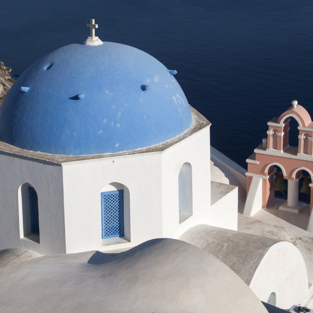 """Clifftop Greek Orthodox Church and Belltower on Santorini"" stock image"